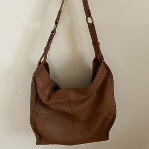 The Sak brand leather bag with bronze details